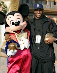 Reggie Bush accepting a bribe from well known USC booster Mickey Mouse.
